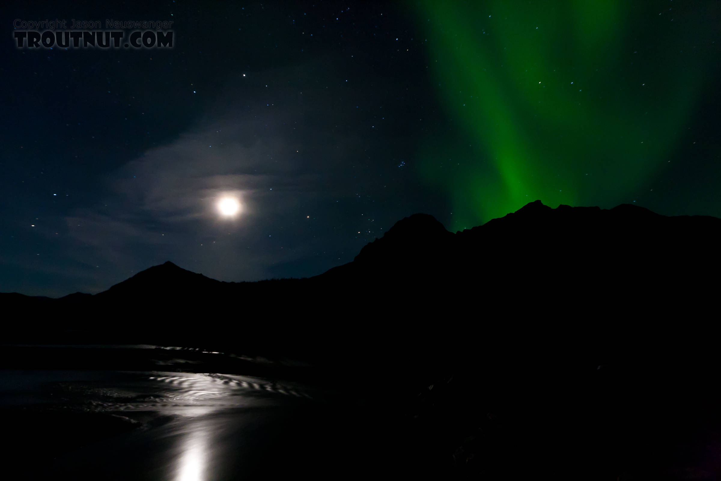 These were the first aurora I saw after moving to Alaska, rising over a mountain above the moonlit Middle Fork of the Koyukuk River in the Brooks Range above the Arctic Circle. From the Middle Fork of the Koyukuk River in Alaska.