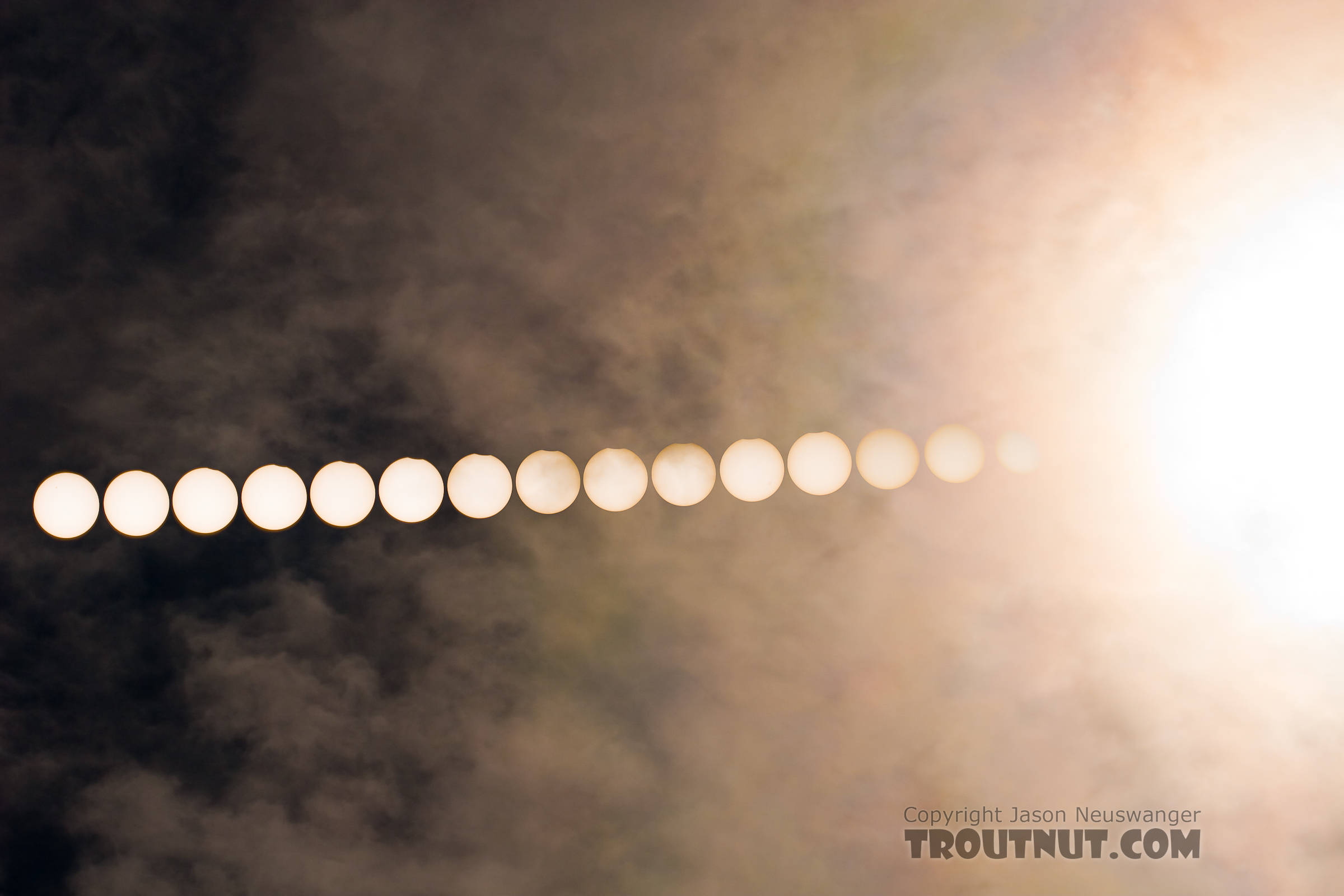 This partial solar eclipse today was most prominent across parts of Siberia, the Arctic Ocean, and Scandanavia, but I caught the outer edge of it here in Fairbanks, Alaska.  I went out to a quiet spot next to the Tanana River behind the airport, and shot this composite photo of several short exposures of the sun during the eclipse, and one longer exposure at the end, capturing the thin clouds that crept into the frame. From the Tanana River in Alaska.