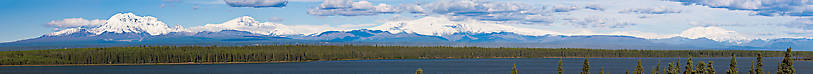 Here's a panorama of the Wrangell Mountains, viewed from a pullout overlooking Willow Lake along the Richardson Highway near Glennallen, Alaska.  A day this clear is rare, and the view is spectacular.  You have to view it full-sized to begin to appreciate what it's like scanning this range with binoculars. From Richardson Highway in Alaska.
