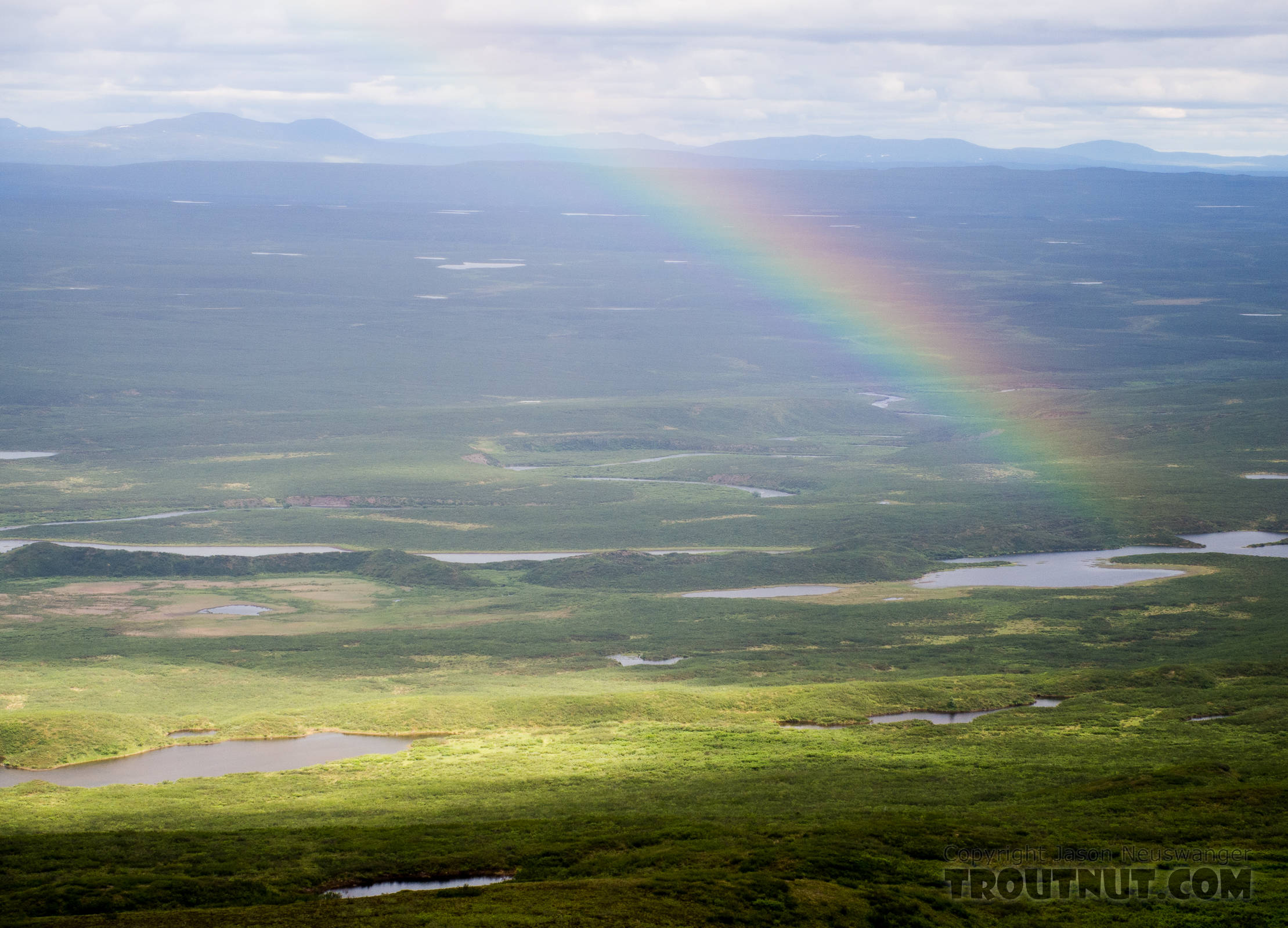 Rainbow over the Clearwater Creek valley. From Clearwater Mountains in Alaska.