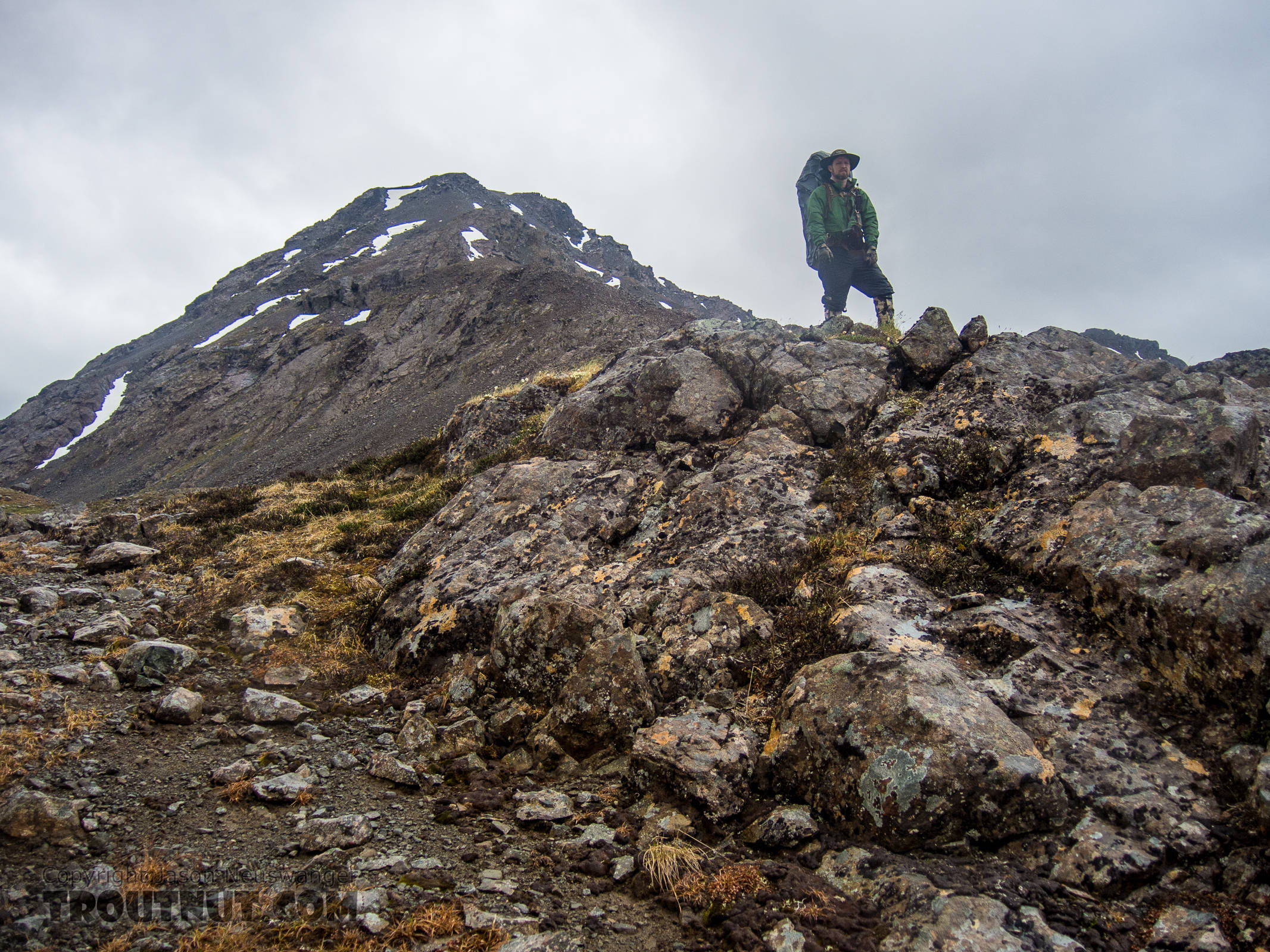 Standing atop the pass checking out the route down. From Clearwater Mountains in Alaska.