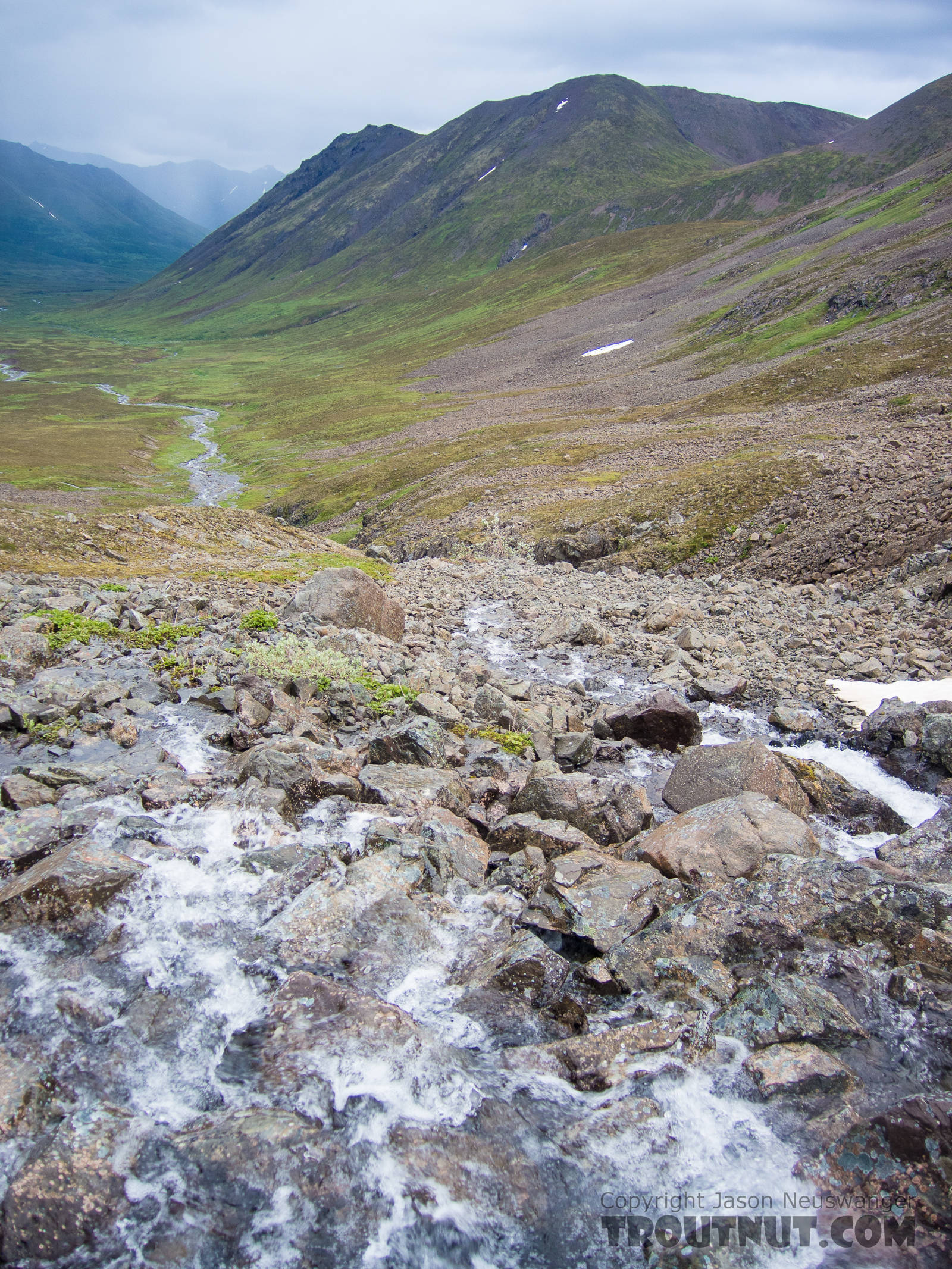 High rocks at the beginning of a little mountain stream From the South Fork of Pass Creek in Alaska.