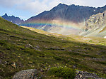 Rainbow over upper Alpine Creek From Clearwater Mountains in Alaska.