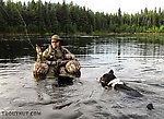 Helpful husky. Taiga wanted to spend the whole evening swimming in tight circles around me. From Mile 36.6 Pond in Alaska.