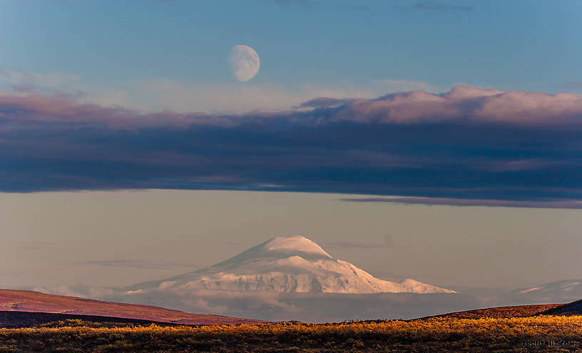 Moonrise over Mt Sanford. An unusually clear view of this mountain from 90 miles away on the Denali Highway From Denali Highway in Alaska.