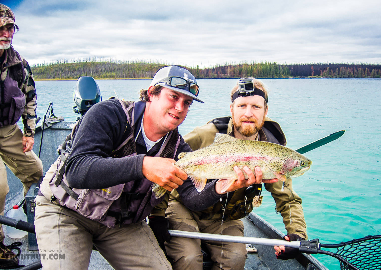 """Big rainbow (estimated 25"""") in the middle Kenai River. Our drift boat guide (Jeff from Alaska Troutfitters) had a policy that he holds the fish instead of the clients, which felt weird to me but is completely understandable given the diverse clientele and the amount of pressure on these fish. Mishandling by inexperienced clients could add up to a lot of mortality. From the Kenai River in Alaska."""