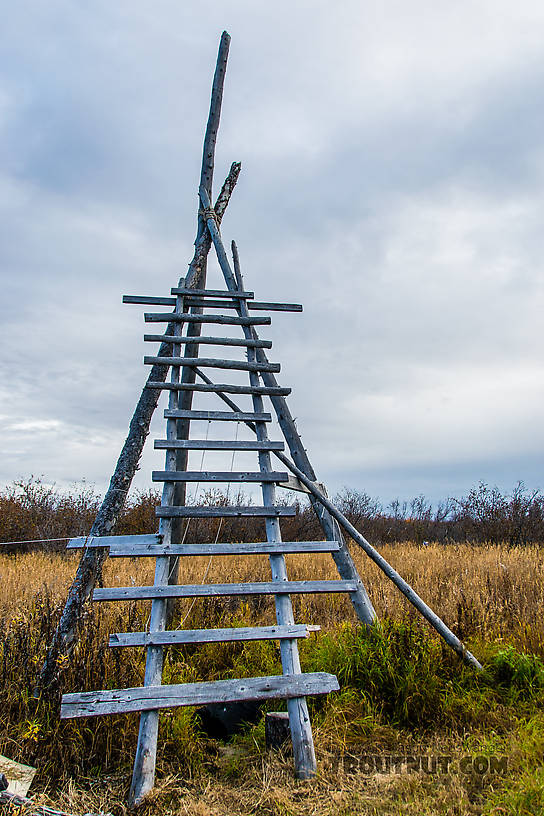 Tower at eskimo cabin for watching for caribou on distant hills From the Selawik River in Alaska.