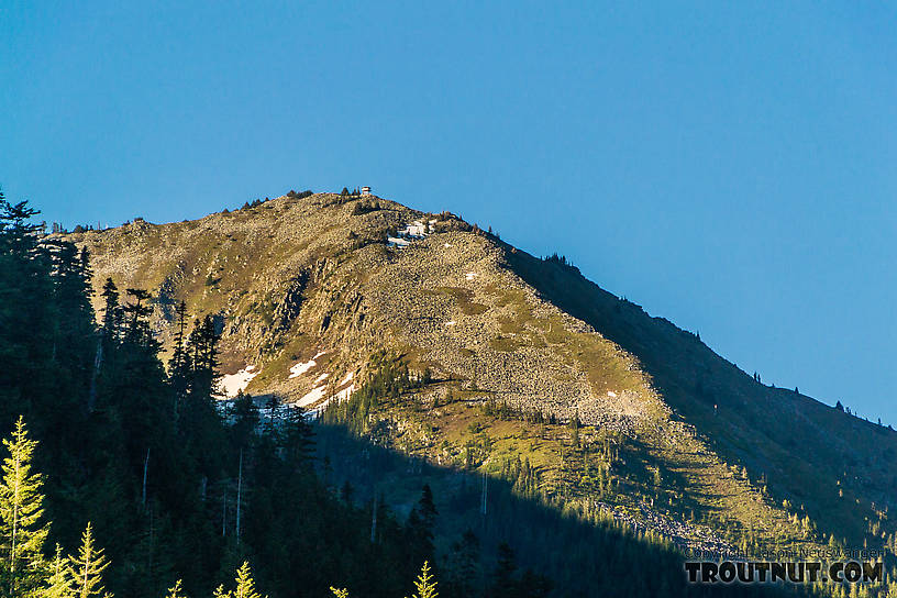 Granite Mountain with Granite Mountain Lookout tower on top From the South Fork Snoqualmie River in Washington.