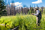 My wife Lena fishing a nice mountain meadow From Mystery Creek # 199 in Washington.
