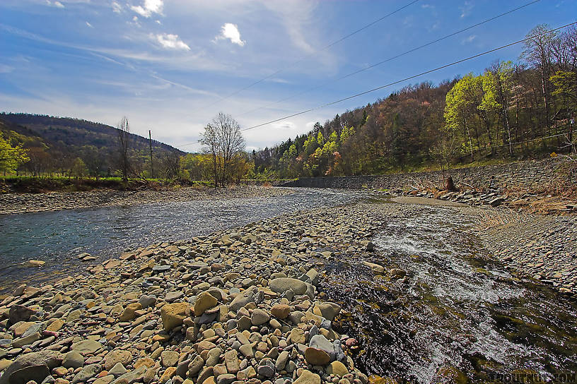 A swift tributary of a Catskill trout stream slides down its own high delta of boulders and cobble. From the Beaverkill River, Horton Bridge Pool in New York.