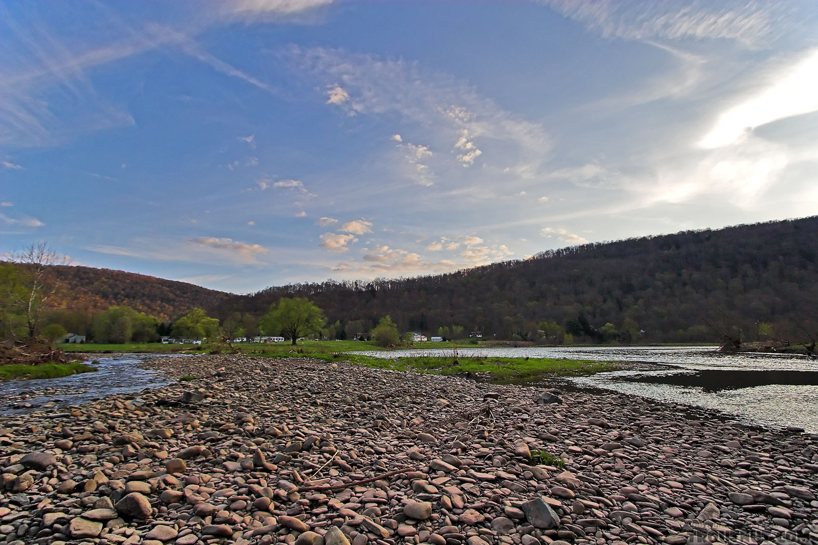 A tributary on the left approaches the large Catskill river on the right. From the West Branch of the Delaware River in New York.