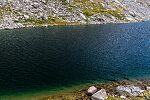 Deep dark waters of Mistake Lake From Titcomb Basin in Wyoming.