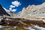 Waterfalls over smooth bedrock above Titcomb Lakes From Titcomb Basin in Wyoming.