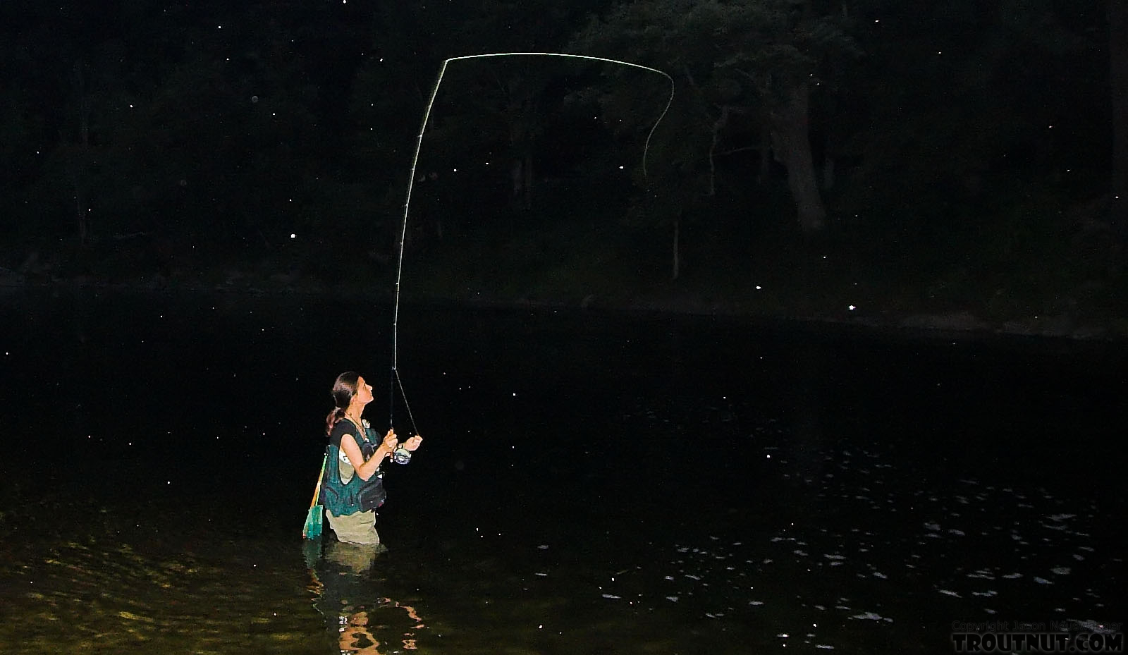 My girlfriend casts amidst a mix of bugs hatching in mid-July from a Catskill stream. From the East Branch of the Delaware River in New York.