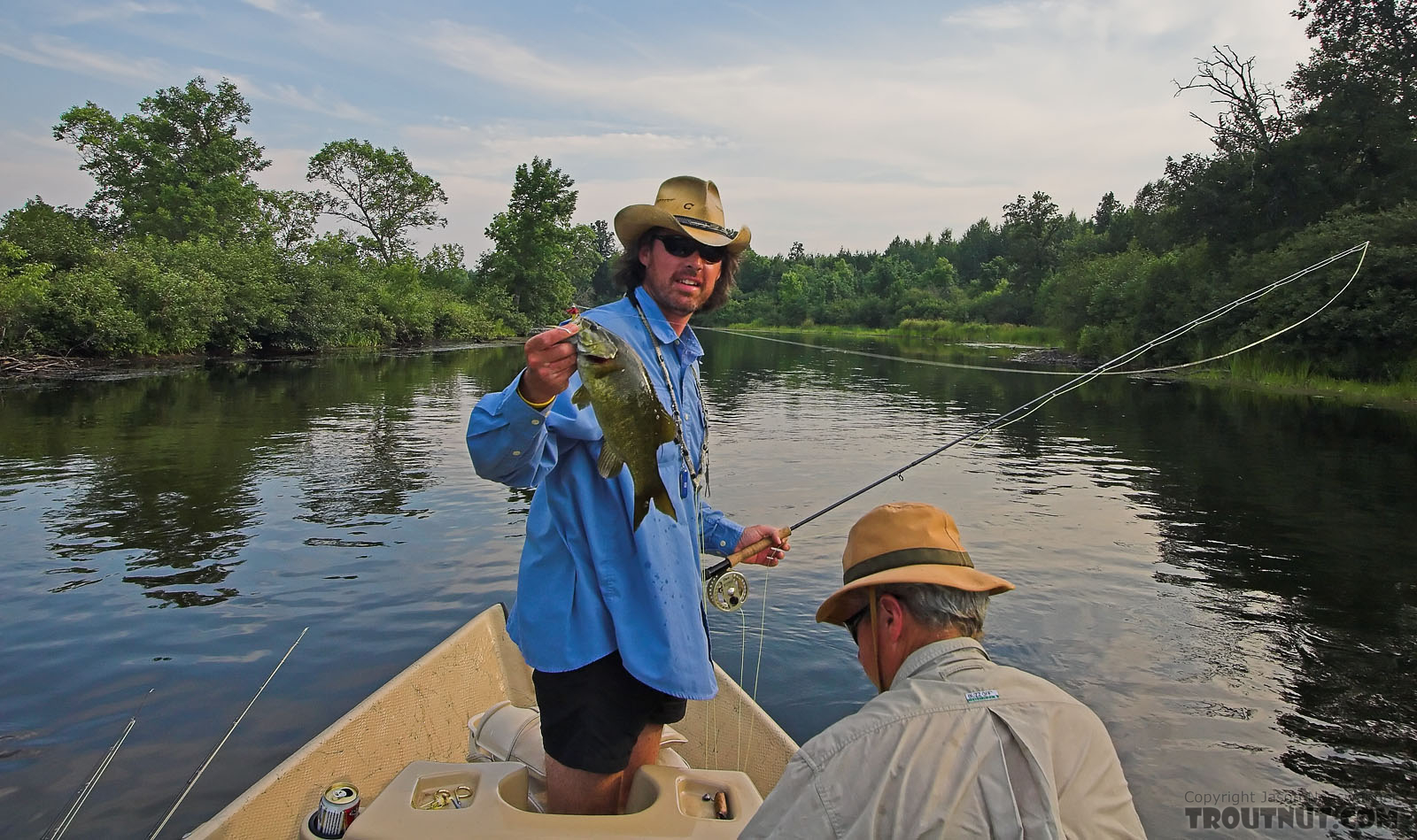 My friend Brad Bohen holds up a nice fly-caught smallmouth. From the Namekagon River in Wisconsin.