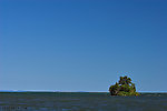 A little island holds its ground against the vastness of Lake Superior. From Lake Superior in Wisconsin.