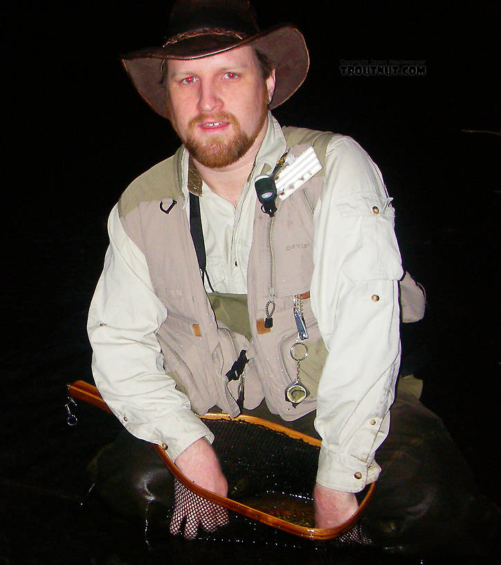 I took great care to handle the best fish of the night, a 16+ inch rainbow trout, very gently for a picture.  As usual, the fish slipped away before the photo.  Here's one snapped too early, while I fumbled with the trout in the net.  It's really there!  Honest! From the Bois Brule River in Wisconsin.