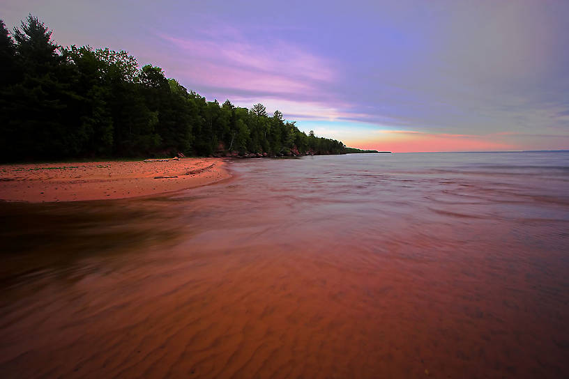 This is the shore of a beautiful island in Lake Superior.  To the left is a narrow channel leading to a a large, shallow bay. From Big Bay on Madeline Island in Lake Superior in Wisconsin.