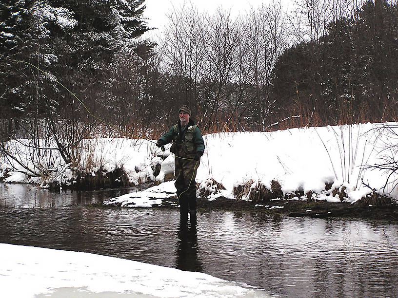 My dad throws a cast on opening day, 2004. From the Mystery Creek # 19 in Wisconsin.