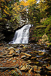 I kneel on a rock trying to catch brookies in a waterfall pool. From Mystery Creek # 89 in New York.