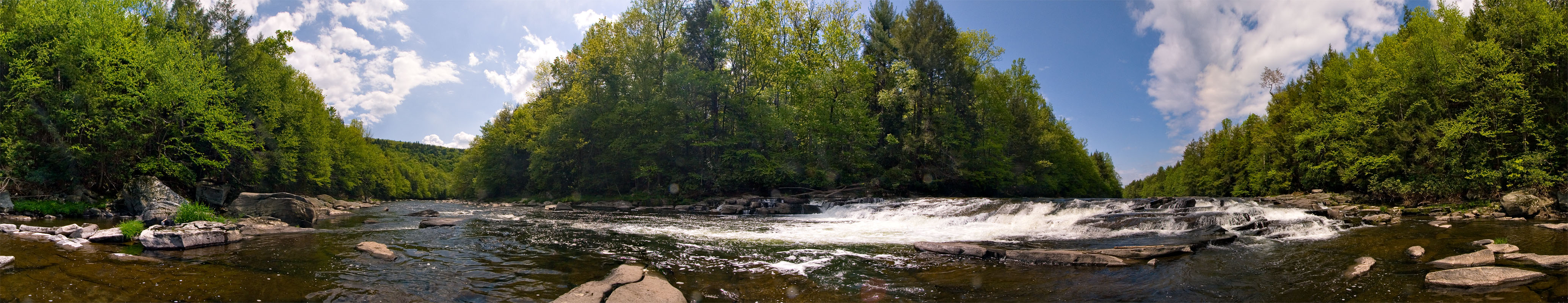 You've really got to see this one full-size to enjoy it.  It's my first attempt at a 360 degree panorama stitched together with the latest and greatest version of Adobe Photoshop.   From the Neversink River in New York.