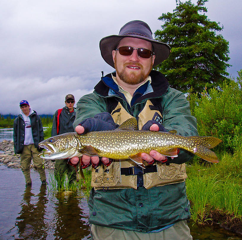 This is my first-ever lake trout, caught on a spinner before we stopped to unpack the fly rods near the beginning of a 4-day float trip.  I caught another of about the same size soon thereafter.  The coloration is incredible compared to other lakers I've seen -- a much more believable cousin to the brook trout. From the Gulkana River in Alaska.