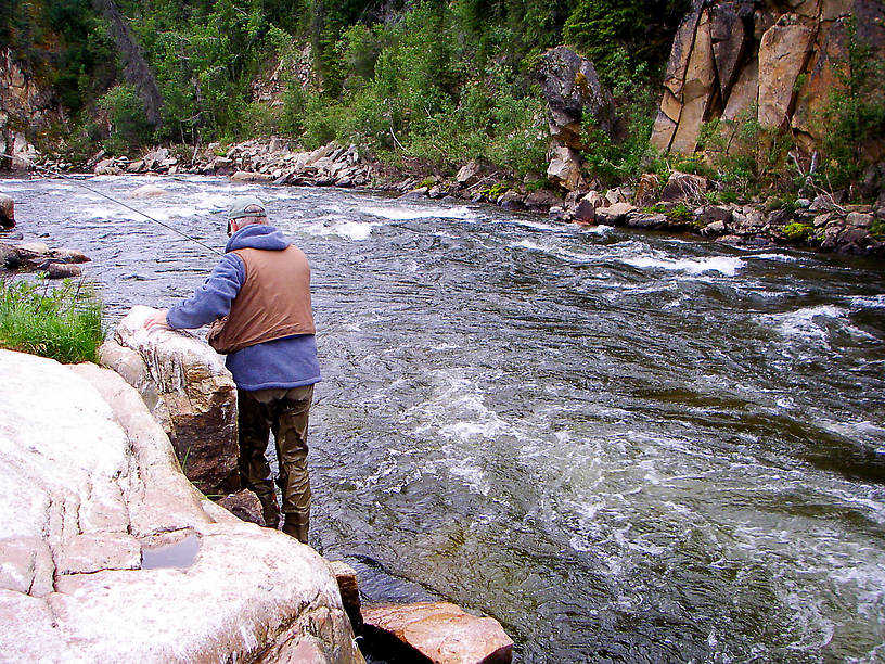 My dad scrambles along the rocks at the base of this canyon as an 18-inch, wild Alaskan rainbow gives him the best fight he's ever had from a fish. From the Gulkana River in Alaska.