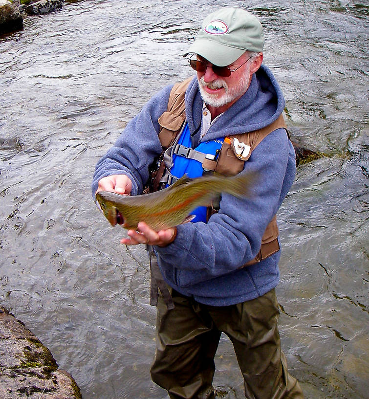 Here my dad drops his largest resident rainbow ever, after a spectacular fight.  It's a good 18 inches.  From the Gulkana River in Alaska.