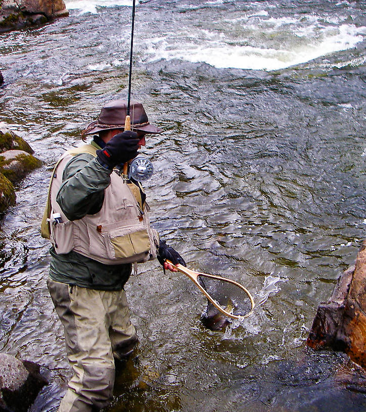 Here I'm netting a nice rainbow in the rapids. From the Gulkana River in Alaska.
