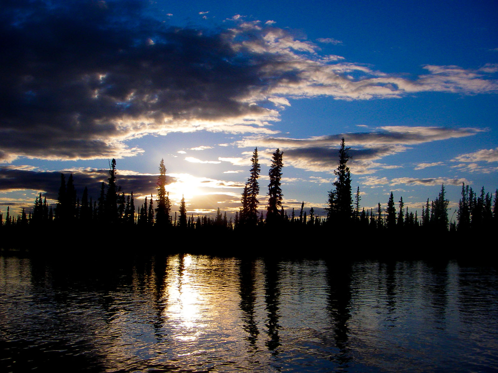 The sun slooowly sets over a crystal-clear grayling stream. From the Delta Clearwater River in Alaska.