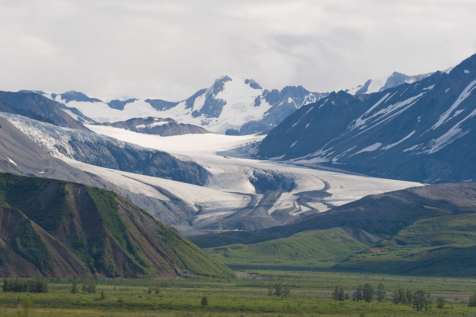 The Gulkana Glacier is an iconic landmark for north-bound travelers (or, I suppose, south-bound travelers looking north) on the Richardson Highway.  Thankfully, its silty runoff drains not into the Gulkana River drainage but into Phelan Creek in the Yukon drainage instead. From Richardson Highway near Summit Lake in Alaska.