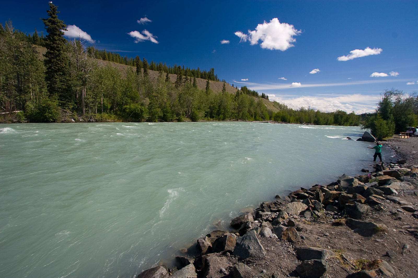 This glacial river's blue-green water is incredibly opaque, but much prettier than the gray-brown of most other glacial rivers.  It is also fishable, though I prefer more clarity. From the Klutina River in Alaska.