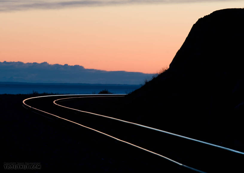 Sunset over the Alaska Railroad tracks along the Turnagain Arm of Cook Inlet, photographed on my drive back home to Fairbanks from the Kenai Peninsula. From Turnagain Arm of Cook Inlet in Alaska.