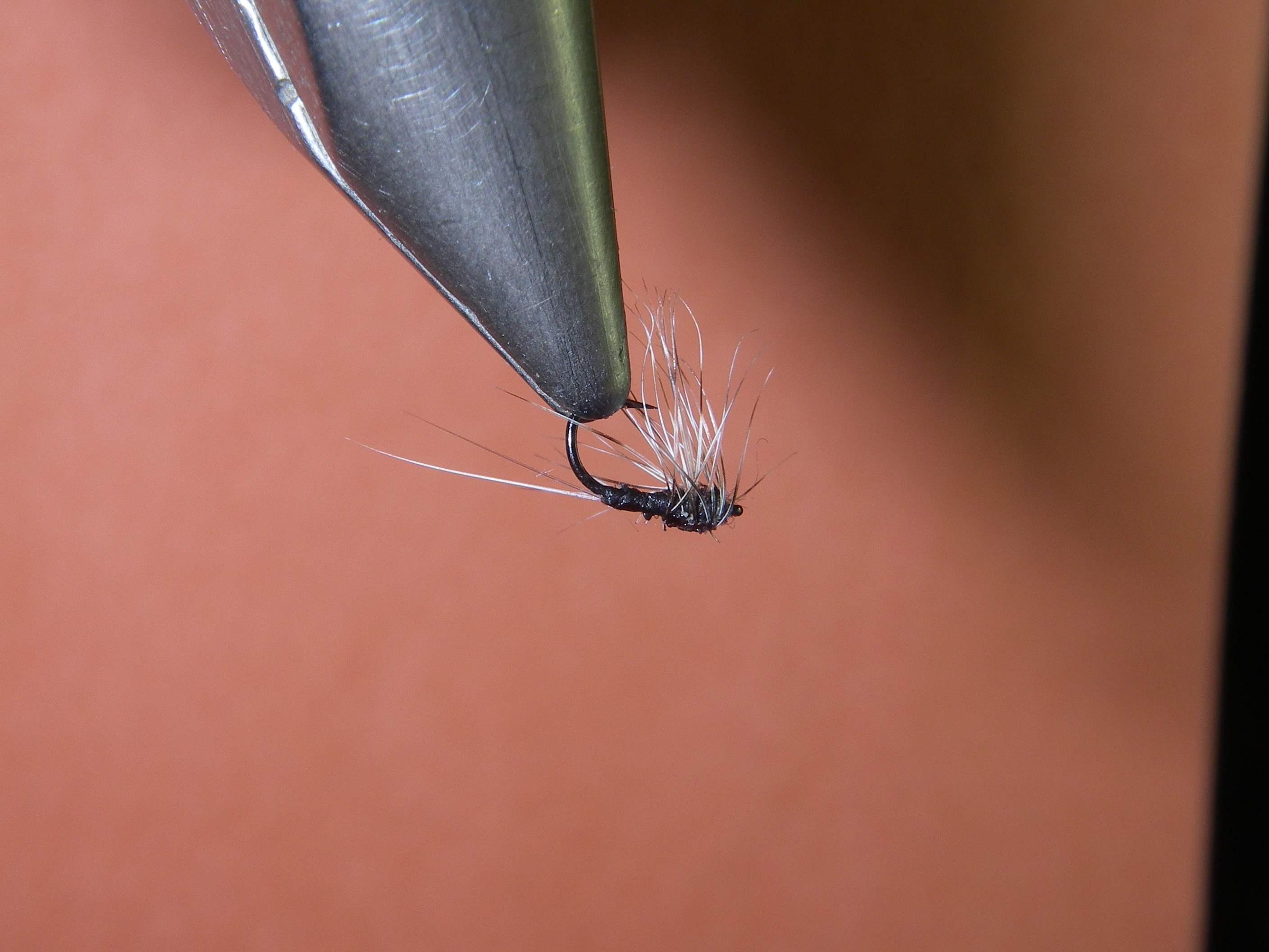 """I can't take credit for this one.  Louis tied this, and I stole it from his box.  An upside down """"compara-hackle"""" trico dun/spinner.  I believe this is tied on the Varivas 2300 hook.  I hope that he comments on the materials used.  I stole two of them, and the other is in the jaw of a fat 16"""" brown. Very delicate and a great fly on really pressured fish."""
