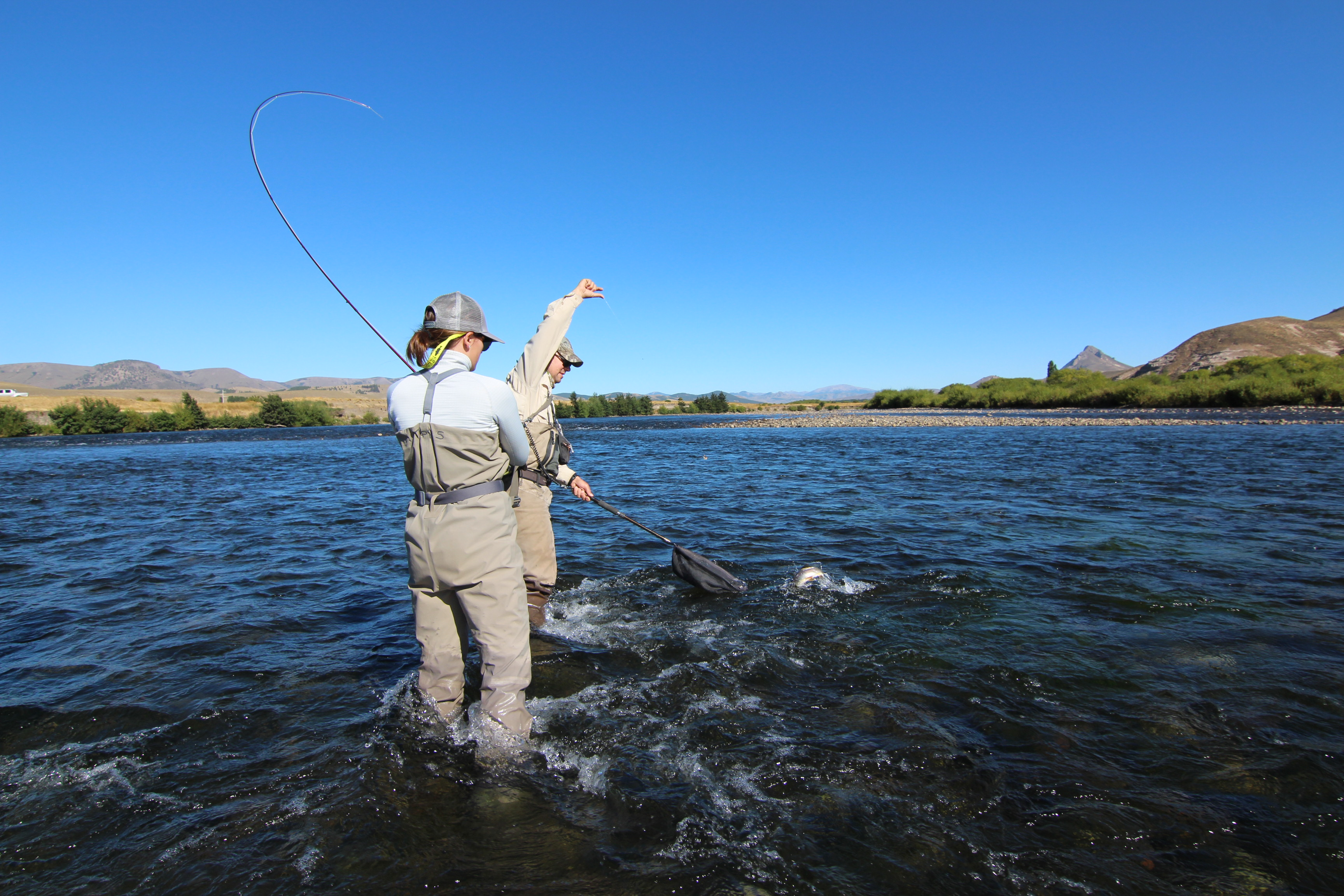 i love this shot of my wife landing a bruiser rainbow (trucha arcoiris locally) on the mighty Chimeuin River
