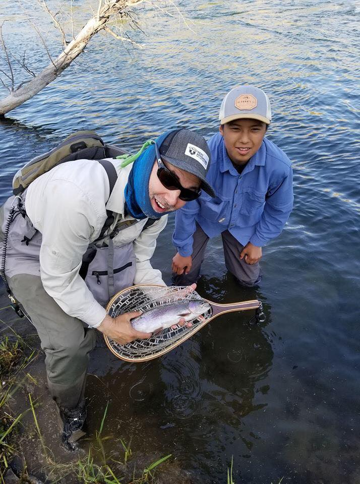 Marv, with Shane, Elke and Alysia's son.  And a beautiful rainbow trout.
