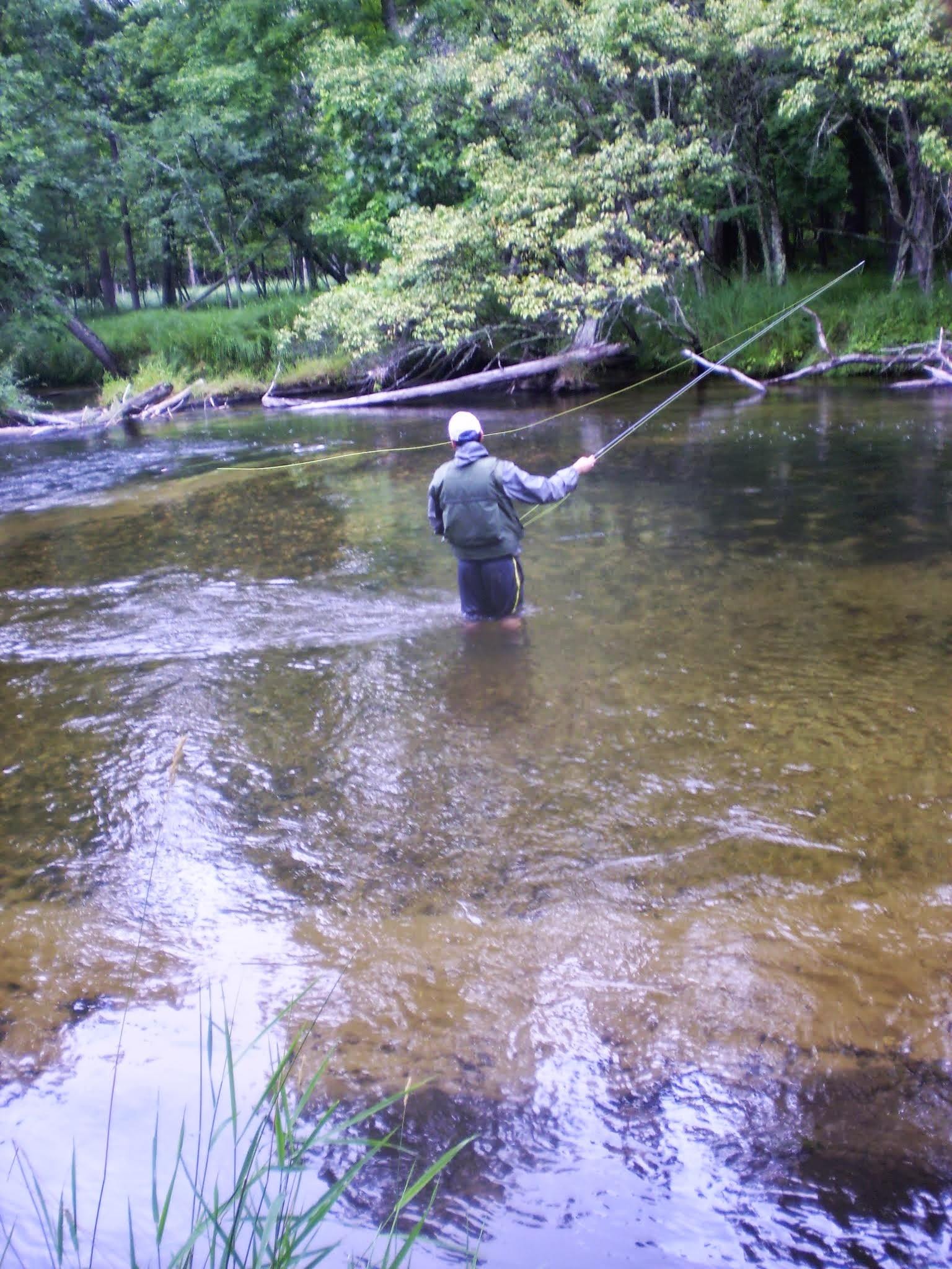 Fishing the Pere Marquette's fly only water.