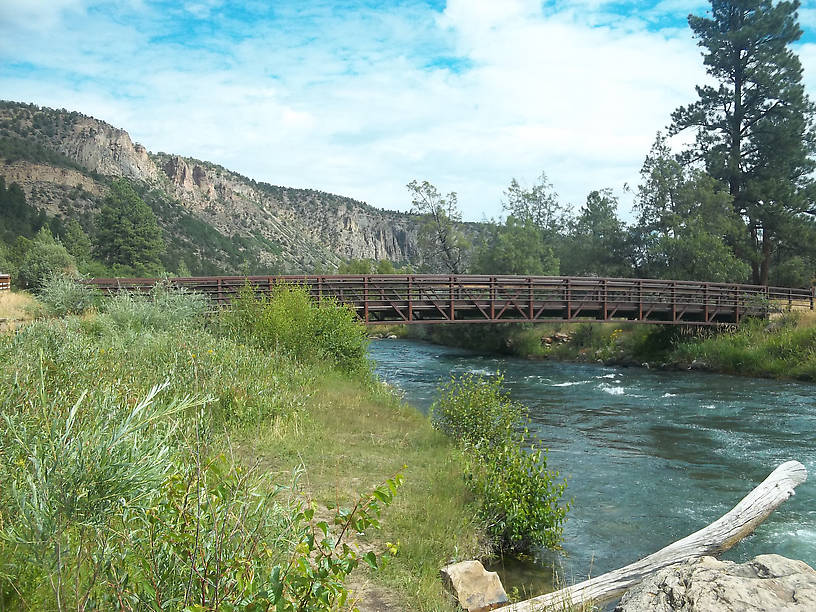 The Uncompahgre tailwaters near camp (a small footbridge allows anglers to fish both sides of the stream without attempting a difficult crossing.)