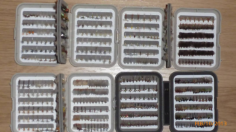 "A close-up of four of my six C&F boxes. The two boxes in the upper row are various PMD emergers, duns, and spinners and also a gazillion cinnamon CDC caddis adults, pupa, and spent caddis.  THe bottom left hand box is all Ep dorothea (Sulfur) emergers, duns, and spinners in #18 - #22.  There is a Myran box for the #16 duns and emergers and a larger 4"" x 6"" box for Ep invaria #14.  I've got my boxes set-up to be hatch specific.  Separate boxes for every hatch that I encounter on the Delaware system and the Montana tailwaters and spring creeks."