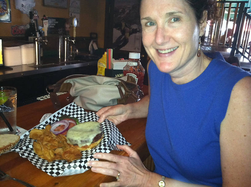 Lisa and her Bison Burger in Red Lodge Montana