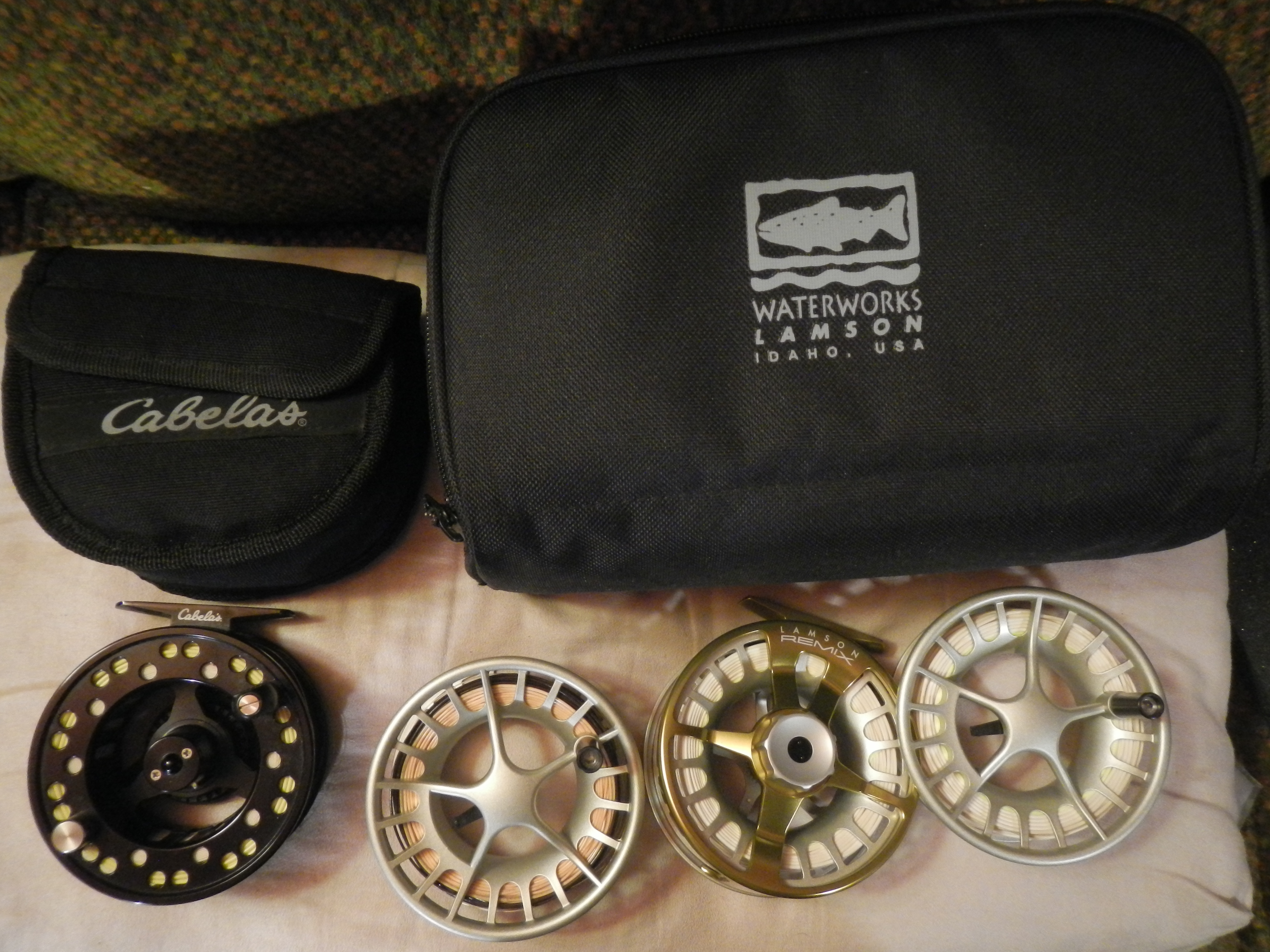 ...the saltwater fly reels are at the ready, and if you count spools they outnumber the spinning reels! Yup, the Lamson 3-pack is new, and loaded with three 7-weight lines I have had for ? long: WF Fl, DT Fl, WF ST