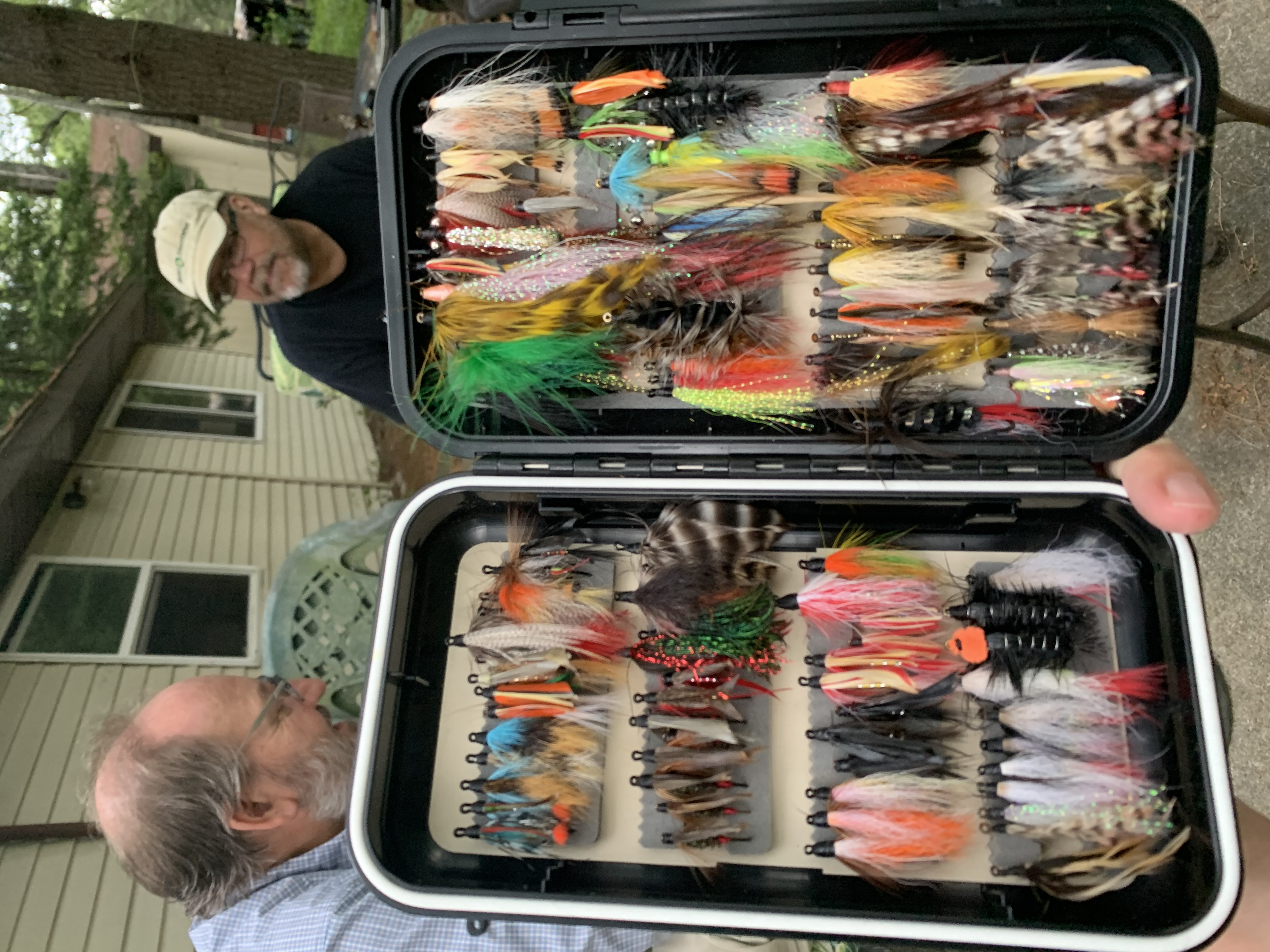 """Todd was so impressed by my """"classic wets and streamers"""" box (yes, I tied all of them) he snapped a pic with Joe & I in the background"""