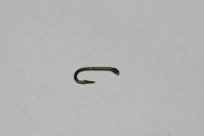 Here it is, next to a size-26 hook for comparison.
