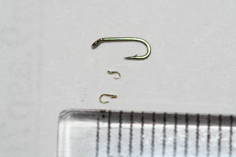 My 3rd and 4th attempts, after having made a pair of tweezers specifically for this purpose.  The larger hook is 1.75 mm long, and the smaller one is 1.30 mm long.